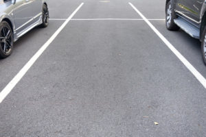space between cars in parking lot